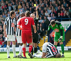 02.04.2011, The Hawthorns, West Bromwich, ENG, PL, West Bromwich Albion vs Liverpool FC, im Bild Liverpool's Andy Carroll is shown the yellow card by referee Mark Atkinson during the Premiership match against West Bromwich Albion at The Hawthorns, EXPA Pictures © 2011, PhotoCredit: EXPA/ Propaganda/ D. Kendall *** ATTENTION *** UK OUT!