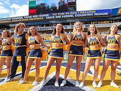Sep 18, 2021; Morgantown, West Virginia, USA; West Virginia Mountaineers cheerleaders celebrate after defeating the Virginia Tech Hokies at Mountaineer Field at Milan Puskar Stadium. Mandatory Credit: Ben Queen-USA TODAY Sports