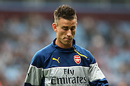 Laurent Koscielny of Arsenal leaves the field after pre-match warm up. Barclays Premier league match, Aston Villa v Arsenal at Villa Park in Birmingham on Saturday 20th Sept 2014<br /> pic by Mark Hawkins, Andrew Orchard sports photography.