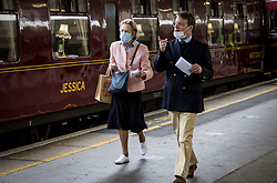 © Licensed to London News Pictures. 20/05/2021. London, UK. Passengers board The world famous LNER Flying Scotsman steam locomotive as it prepares to leave Victoria Station in central London ahead of a tour through the Surrey Hills in South east England. The heritage steam locomotive touring season was mostly cancelled last year due to the Covid-19 pandemic but is now underway as restrictions are eased. Built in 1923 for the London and North Eastern Railway (LNER)It was the first steam locomotive to reach 100 miles per hour . Photo credit: Ben Cawthra/LNP