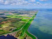 Nederland, Noord-Holland, gemeente Hollands Kroon, 07-05-2021; Wieringermeer, Wieringerwerf, Noorderdijkweg nabij het Dijkgatbos. Naast het Noordelijk Wiel een dijkmagazijn, Den Oever en begin van de Afsluitdijk in het verschiet.Wieringermeer, Wieringerwerf, Noorderdijkweg near the Dijkgatbos. Next to the Noordelijk Wiel a dike warehouse, Den Oever and the beginning of the Afsluitdijk in the distance.<br /> luchtfoto (toeslag op standard tarieven);<br /> aerial photo (additional fee required)<br /> copyright © 2021 foto/photo Siebe Swart
