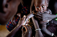 Children receive vaccinations in South Sudan.