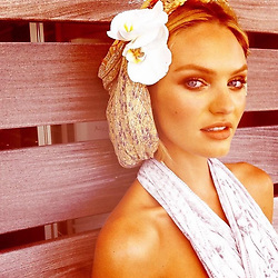 """Candice Swanepoel releases a photo on Instagram with the following caption: """"\ud83c\udf3afrom the archives"""". Photo Credit: Instagram *** No USA Distribution *** For Editorial Use Only *** Not to be Published in Books or Photo Books ***  Please note: Fees charged by the agency are for the agency's services only, and do not, nor are they intended to, convey to the user any ownership of Copyright or License in the material. The agency does not claim any ownership including but not limited to Copyright or License in the attached material. By publishing this material you expressly agree to indemnify and to hold the agency and its directors, shareholders and employees harmless from any loss, claims, damages, demands, expenses (including legal fees), or any causes of action or allegation against the agency arising out of or connected in any way with publication of the material."""