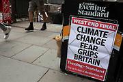 Climate change headline on the Evening Standard newspaper board outside Bank Station in London, England, United Kingdom.