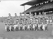 Neg No:.573/7856-7864...15081954AISFCSF...15.08.1954...All Ireland Senior Football Championship - Semi-Final..Kerry.2-6.Galway.1-6.Kerry. ...G. O'Mahony, J. M. Palmer, E. Roche, D. Murphy, Sean Murphy, J. Cronin, C. Kennelly, John Dowling (Captain), T. Moriarty, R. Buckley, J. J. Sheehan, P. Sheehy, J. Brosnan, S. Kelly, T. Lyne. .John Dowling (Captain).
