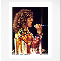 """Roger Daltrey 1 - An affordable archival quality matted print ready for framing at home.<br /> Ideal as a gift or for collectors to cherish, printed on Fuji Crystal Archive photographic paper set in a neutral mat (all mounting materials are acid free conservation grade). <br /> The image (approx 6""""x8"""") sits within a titled border. The outer dimensions of the mat are approx 10""""x12""""."""