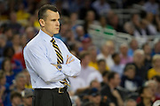 Head coach Billy Donovan of the University of Florida Gators looks on as his team faces off against the Florida Gulf Coast University Eagles during the NCAA South Regionals at Cowboys Stadium in Arlington on Friday, March 29, 2013. (Cooper Neill/The Dallas Morning News)