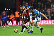 Joshua King (17) of AFC Bournemouth battles for possession with Christopher Schindler (26) of Huddersfield Town during the Premier League match between Bournemouth and Huddersfield Town at the Vitality Stadium, Bournemouth, England on 4 December 2018.