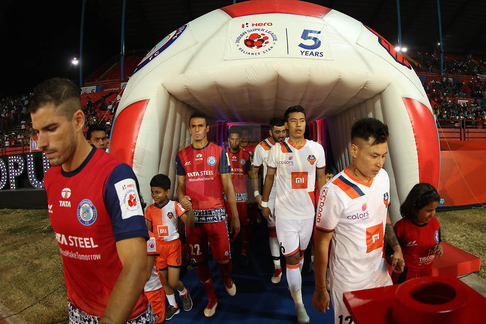 Players entering on the field with children escorts during match 25 of the Hero Indian Super League 2018 ( ISL ) between Jamshedpur FC and FC Goa held at JRD Tata Sports Complex, Jamshedpur, India on the 1st November  2018<br /> <br /> Photo by Saikat Das /SPORTZPICS for ISL