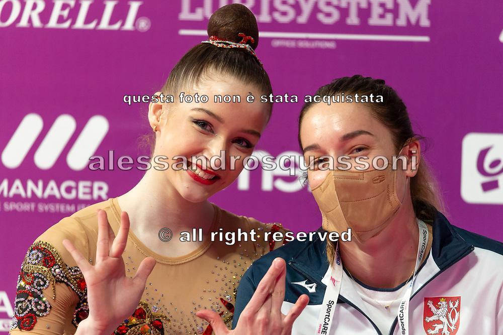 Barbora Kafkova sitting at the Kiss and Cry of the Rhythmic Gymnastics World Cup in Pesaro.