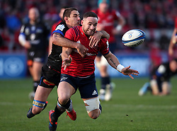 Munster's Alby Mathewson is tackled by Castres Olympique Yannick Caballero during the Heineken European Champions Cup, pool two match at Thomond Park, Limerick.