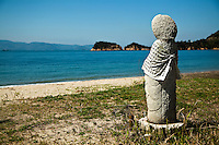 Jizo overlooking the beach at Naoshima - an island located in the Seto Inland Sea.  The small island is known for its contemporary art museums and public art.  Benesse Corporation, one of the largest education companies in Japan, has directed the creation and operation of the island's museums and other projects since the late 1980s.