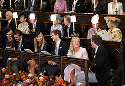 (Front row right to left) Mr and Mrs Alexander Farr, Mr and Mrs Wiliam Gayner and Mr and Mrs Rory Chichester. (2nd row right to left) Nicola Brooksbank, Amy Rodgers, Mr and Mrs David Broosksbank, Mr and Mrs Christopher Newton, John Newton take their seats ahead of the wedding of Princess Eugenie to Jack Brooksbank at St George's Chapel in Windsor Castle.