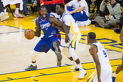 Golden State Warriors forward Draymond Green (23) defends LA Clippers forward Montrezl Harrell (5) at Oracle Arena in Oakland, Calif., on January 10, 2018. (Stan Olszewski/Special to S.F. Examiner)