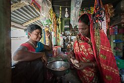 16 September 2018, Sohal Tole, Jahada rural municipality, Nepal: Lila Devi Shah runs a small grocery shop in Sohal Tole, Jahada Rural Municipality, Nepal, together with her family member Laxmi Shah. Sohal Tole is a community inhabited by Santal and Dalit (Musahar) people, who find themselves as the very margin of society in Nepal. The 54 households are supported by the Nepal Evangelical Lutheran Church, as they mobilize together on disaster preparedness, income generating activities, financial governance, and mobilization on sanitation, education and entrepreneurship. The community project also receives technical support from the Lutheran World Federation World Service programme.