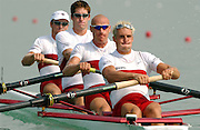 © Peter Spurrier/Sports Photo.email images@intersport-images.com.Tel +44 7973 819 551.Photo  Peter Spurrier.28/08/2003 Thursday.2003 World Rowing Championships, Idroscala. Milan, Italy.'Focus concentration' Semi finals, men's four,  Canada's  [left to right] CAN M4-Cameron Baerg, Thomas Herschmiller, Jake Wetzel and  Barney Williams, at the start of their semi final . . Milan. ITALY 2003 World Rowing Championships. Idro Scala Rowing Course. [Mandatory Credit: Peter Spurrier: Intersport Images.]
