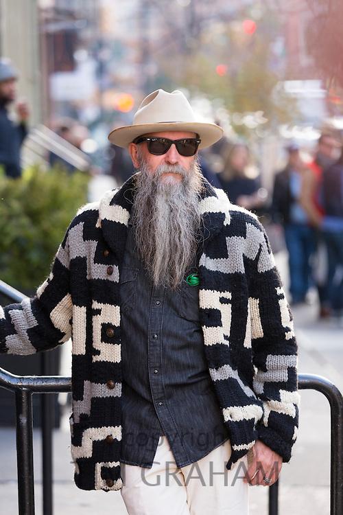 Male sartorial elegance look, men's co-ordinates fashion and shades worn by stylish man with long grey beard, Soho, New York USA