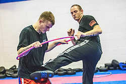 Stef Noij, KMG Instructor from the Institute Krav Maga Netherlands, kicks the hoop, during the IKMS G Level Programme seminar today at the Scottish Martial Arts Centre, Alloa.