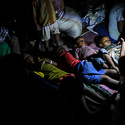 HAMDAYET, SUDAN - DECEMBER 6, 2020: Refugees from the Tigray region of Ethiopia prepare to sleep outside without shelter as they wait to be transferred to a camp with more infrastructure at a UNHCR reception area in the east Sudanese border village of Hamdayet on December 6, 2020 in Hamdayet, Sudan. Last week, the Ethiopian government declared victory in its nearly monthlong battle with the Tigray People's Liberation Front (TPLF), which sent 45,000 people fleeing to Sudan and displaced thousands more within the Tigray Region. In recent days, Ethiopian forces have prevented even more people from crossing the border into Sudan, while a TPLF spokesman said that fighting had continued outside of Mekelle, Tigray's regional capital. (Photo by Byron Smith/Getty Images)