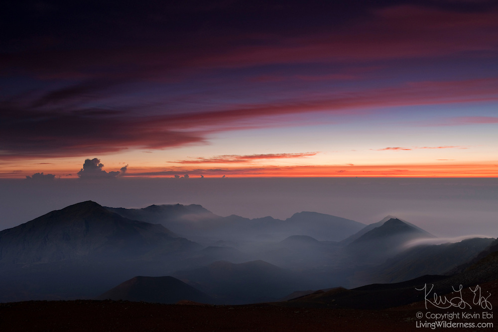 An approaching fall storm results in a colorful twilight sky above Haleakala National Park on the Hawaiian island of Maui.
