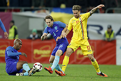 (L-R) Ryan Babel of Holland, Daley Blind of Holland, Eric Bicfalvi of Romania during the friendly match between Romania and The Netherlands on November 14, 2017 at Arena National in Bucharest, Romania