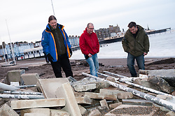 © London News Pictures. 05/01/2014. Aberystwyth, UK.  Damage caused to the promenade in Aberystwyth, Wales which is littered with debris following days of high tides and storms. Much of the seafront has been severely damaged by the pounding pif the waves, with the likely cost of repairs running into the millions of pounds. Photo credit Keith Morris: LNP