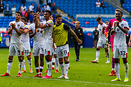 Bournemouth players applaud their fans at the final whistle during the EFL Sky Bet Championship match between Cardiff City and Bournemouth at the Cardiff City Stadium, Cardiff, Wales on 18 September 2021.