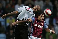 Photo: Lee Earle.<br /> Aston Villa v Fulham. The Barclays Premiership. 21/10/2006. Fulham's Zat Knight (L) battles in the air with Juan Pablo Angel.