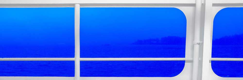 open windows on a Washington state ferry frame blue outside foggy view with a white frame on Puget Sound panorama