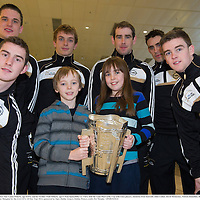 27 November 2013; Clare supporters Amy Louise Doherty, age twelve, and her brother Noah Doherty, age 9, from Spancelhill, Co. Clare, hold the Liam MacCarthy Cup with Clare players, clockwise from back left; John Conlon, David McInerney, Patrick Donnellan, Brendan Bugler, Tony Kelly, and Colm Galvin at Dublin Airport prior to their departure for Shanghai for the GAA GPA All Star Tour 2013, sponsored by Opel. Dublin Airport, Dublin. Picture credit: Pat Murphy / SPORTSFILE
