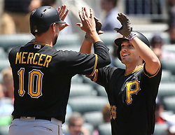 May 25, 2017 - Atlanta, GA, USA - Pittsburgh Pirates' Adam Frazier gets a double high five from Jordy Mercer after hitting a three-run home run against the Atlanta Braves during the second inning in a MLB baseball game on Thursday, May 25, 2017, in Atlanta. The Pirates beat the Braves 9-4. (Credit Image: © Curtis Compton/TNS via ZUMA Wire)