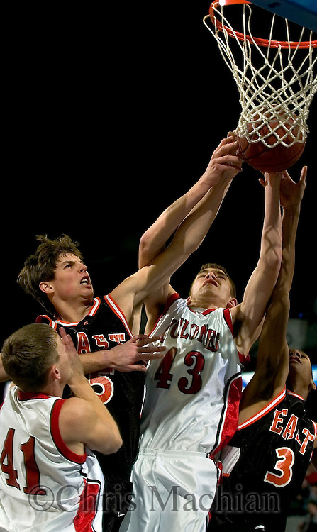 2/11/06 -- Omaha, Ne.Harlan's Neil Gross(No. 43) and Jared Boysen fights for a rebound with Sioux City East's Matt Pluim (No. 3) and Tyler Clause at  The Omaha Shootout, a High School Basketball tournament featuring some of the best prospects at the Qwest Center Omaha...(Photo by Chris Machian/Prarie Pixel Group).