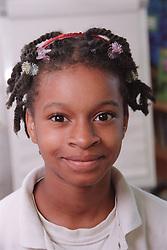 Portrait of primary school girl smiling,