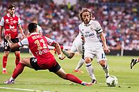 Real Madrid's player Luka Modric and Stade de Reims's player Rigonato during the XXXVII Santiago Bernabeu Trophy in Madrid. August 16, Spain. 2016. (ALTERPHOTOS/BorjaB.Hojas)