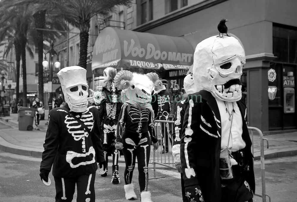 17 Feb 2015. New Orleans, Louisiana.<br /> Mardi Gras Day. Walking with Skeletons. <br /> Walking down Canal Street. The Skeleton Krewe meets before dawn beside a cemetery in Uptown New Orleans. They then walk several miles Along Saint Charles Avenue to the French Quarter to celebrate Mardi Gras Day.<br /> Photo; Charlie Varley/varleypix.com