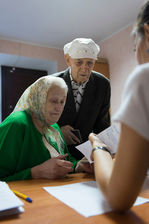 Alexey, age 82, and Raisa, age 80, speak with a representative of the U.N.'s World Food Proagramme in Sloviansk, Ukraine. Due to conflict between the Ukrainian government and separatists, the couple fled their hometown of Debaltsevo on 25 June 2015.<br /><br />(October 2, 2015)