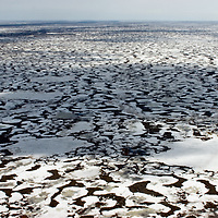 North of the Arctic Circle in Russia, seemingly infinite ponds and bogs appear as the tundra melts free from its winter blanket of snow.  By June, this becomes both impassible and a breeding ground for so many mosquitoes that neither people nor reindeer can stay there.