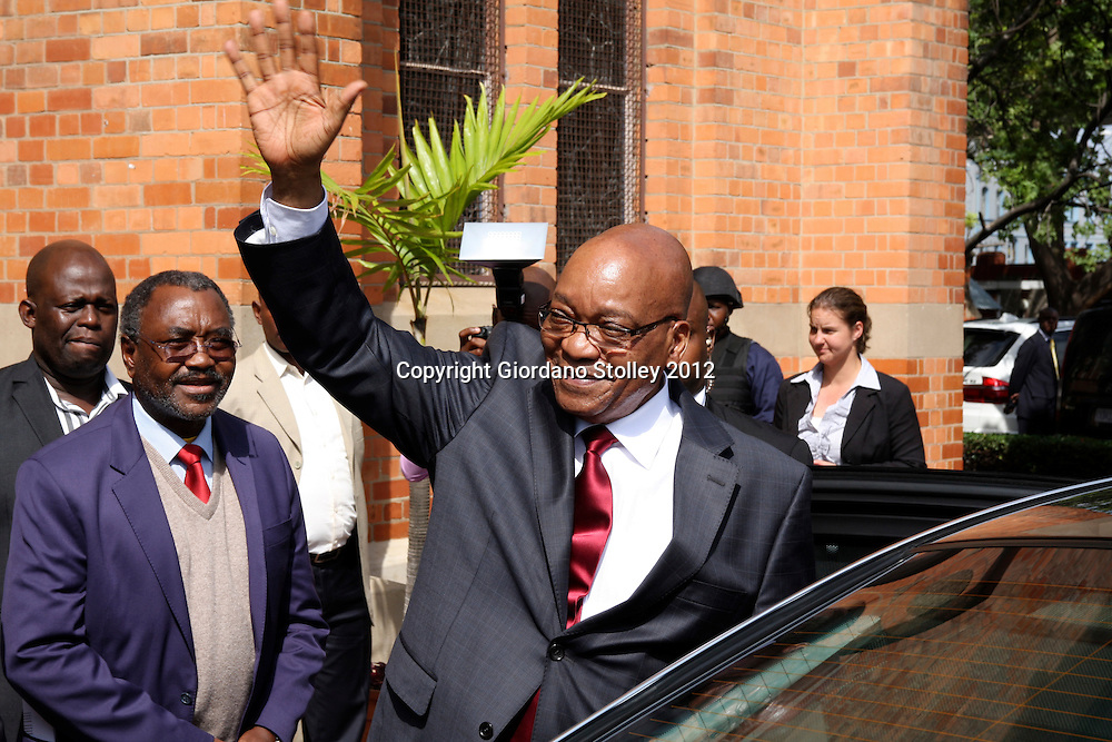 DURBAN - 19 April 2012 - South African President Jacob Zuma waves to supporters outside Durban's Emmanuel Cathedral where mments earlier he had paid his respects at the tomb of Arch Bishop Denis Hurley. On Zuma's left (red tie) is KwaZulu-Natal MEC for Transport, Community Safety and Liaison..Picture: Giordano Stolley/Allied Picture Press/APP