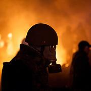 January 24, 2014 - Kiev, Ukraine: Anti-government protestors attack the Ukrainian riot police, outside the Dynamo Kiev stadium near the Independence Square. (Paulo Nunes dos Santos)