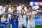 Leeds United midfielder Kalvin Phillips (23) with Leeds United defender Barry Douglas (3) Leeds United forward Ian Carlo Poveda (7) celebrates winning the EFL Sky Bet Championship during the EFL Sky Bet Championship match between Leeds United and Charlton Athletic at Elland Road, Leeds, England on 22 July 2020.