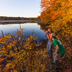 Two men bird watching next to a pond in Marshfield, Massachusetts. Hoyt-Hall Preserve.