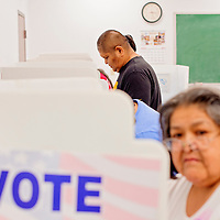 081914       Cable Hoover<br /> <br /> Albert Lementino and others fill out their ballots for the Zuni primary election Tuesday at the Zuni Tribal Office.
