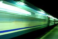 A moving train near a platform