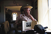William R. Brazel holds a photograph of his father, the rancher who found the wreckage of what has been purported to be the crash of a UFO outside Roswell, New Mexico, in 1947. It was near Roswell on the evening of 2 July 1947 that many UFO sightings were reported during a thunderstorm. Next morning a rancher, Mac Brazel, discovered strange wreckage in a field. When the impact site was located, a UFO craft and alien bodies were allegedly found. On 8 July 1947, the Roswell Daily Record announced the capture of a flying saucer. The official explanation was that it was a crashed weather balloon. Many Roswell inhabitants, however, believe this a cover up, and Roswell has become a symbol for UFO enthusiasts. Model Released (1997).