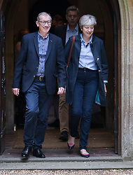 © Licensed to London News Pictures. 03/09/2017. Reading, UK.  Prime Minister Theresa May attends church with her husband Philip. Mrs May is facing pressure from back bench Conservative MPs over the EU repeal bill which is to be debated later this week as Parliament returns from the summer break. Photo credit: Peter Macdiarmid/LNP