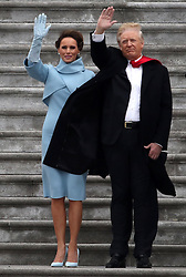 January 20, 2017 - Washington, DC, U.S. - US President DONALD TRUMP waves with first lady MELANIA TRUMP as they watch the helicopter with ex-President Barack Obama take off from the United States Capitol during his inauguration. (Credit Image: © Gary Hershorn via ZUMA Wire)