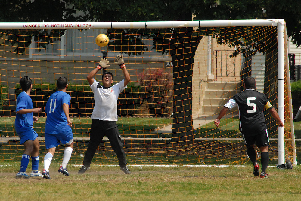 Deportivo Colomex Goal Keeper Jose Cormona blocks an attempt from Team Shlama (blue) during National Soccer League play in Skokie, Il.