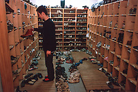 ©Tom Wagner 2004<br /> Students take off their shoes before entering their dorm rooms at Waseda University; Tokyo, Japan.<br /> Japan. Education. Students. University.