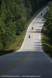 A group of Cannonballers riding together during Stage 3 of the Motorcycle Cannonball Cross-Country Endurance Run, which on this day ran from Columbus, GA to Chatanooga, TN., USA. Sunday, September 7, 2014.  Photography ©2014 Michael Lichter.