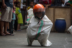 August 17, 2017 - Central Jakarta, Jakarta, Indonesia - Children join the gunny sack race (balap karung) tradition during celebrations for the 72nd Indonesia National Independence day on August 17, 2017 in Jakarta, Indonesia. Indonesia became an independent nation on 17th August 1945, having previously been under Dutch rule. (Credit Image: © Afriadi Hikmal via ZUMA Wire)